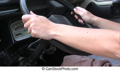 Woman Driving an Old Car