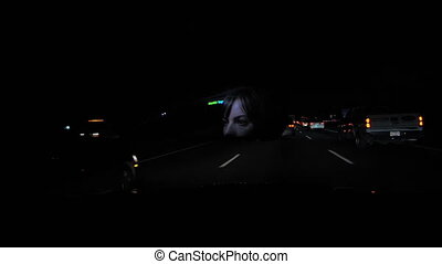 Woman driving at night. - Woman driving at night with face...
