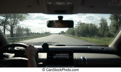 Woman driving car on the motorway in summer