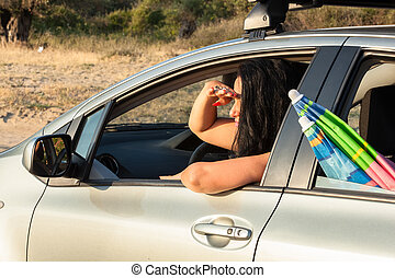 Woman driving car on vacation