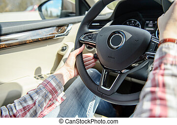 Woman driving changing ruise control setting - Woman wearing...