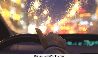 woman driving in a heavy rain in the city