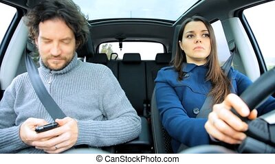 Woman driving jealous of boyfriend - Man texting in car...