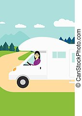 Woman driving motor home. - An asian woman driving a motor...