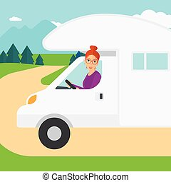 Woman driving motor home. - A woman driving a motor home in...