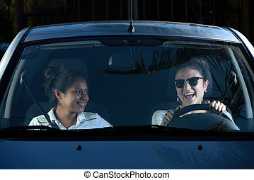 Woman driving with her friend