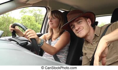 Woman Driving with Man in Passenger Seat on Safari