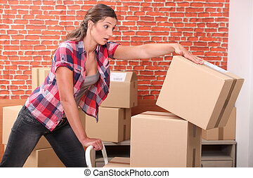 Woman dropping packing boxes