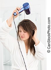 Woman drying hair hair