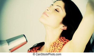 woman drying long hair slow motion