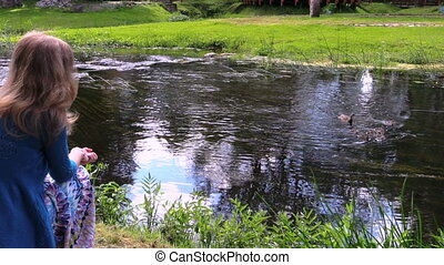 woman ducks river
