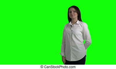 Woman during presentation showing something behind her doing OK gesture