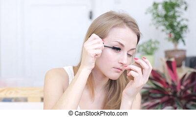 Woman dye her eyelashes - Beautiful young woman dye her...