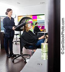 Woman Dying Hair In Beauty Salon