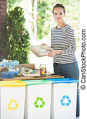Woman easily sorting waste everyday - Sorting waste everyday...