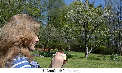 woman eat cake in garden