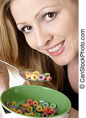 woman eating a bowl of colourful cereal