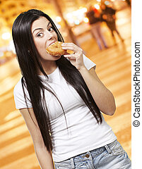 woman eating a donut