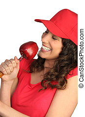 Woman eating a red apple