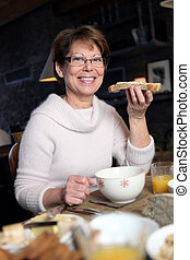 Woman eating a slice of bread
