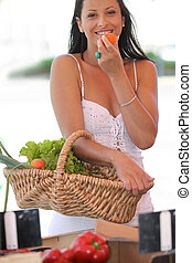 Woman eating an apricot
