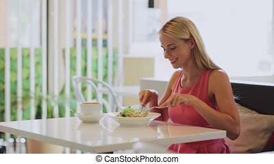 woman eating and drinking coffee at restaurant - food,...