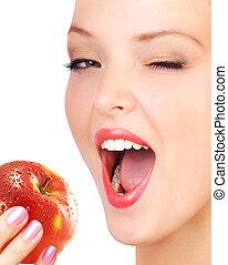 Woman eating apple.