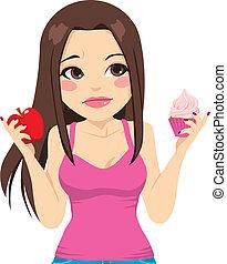 Woman Eating Apple Or Cupcake - Cute woman doubting between...