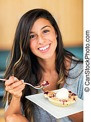 Woman Eating Berry Pie and Ice Cream