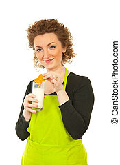 Woman eating biscuit with milk
