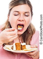 Woman eating cake - Close up of young woman eating carrot...
