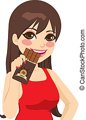 Woman Eating Chocolate Bar - Beautiful brunette woman eating...