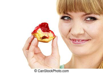 Woman eating cupcake sweet food