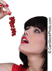 Woman eating currants