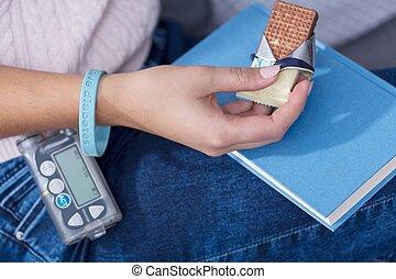 Woman eating diabetic snack