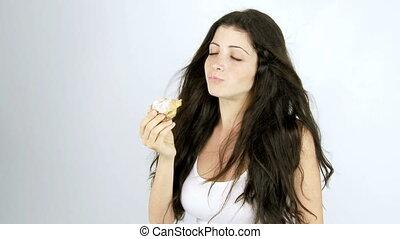 Woman eating fantastic croissant