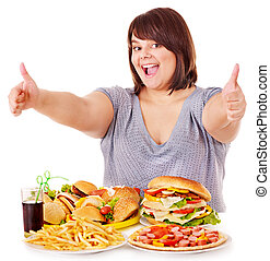 Woman eating fast food. - Overweight woman eating fast food.