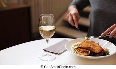 woman eating fish salad at cafe or restaurant - food, new...