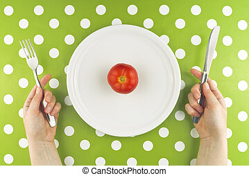 Woman eating fresh red tomato, top view - Woman eating fresh...