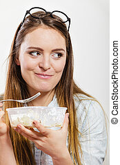 Woman eating fresh vegetable salad.