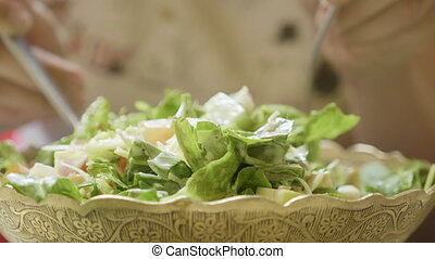 Woman eating green healthy tasty eco salad.