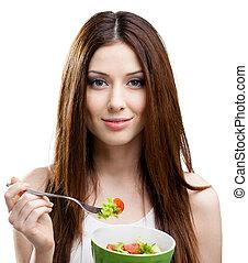 Woman eating green salad - Dieting woman eats fresh salad in...