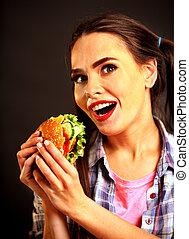 Woman eating hamburger. Girl wants to eat burger. Student...