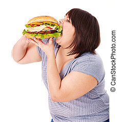 Woman eating hamburger. - Overweight woman eating hamburger...
