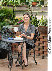 woman eating in a patio