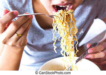 woman eating instant noodles close up