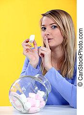 Woman eating marshmallow