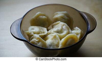 woman eating meat dumplings from glassware. HD video