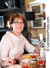 Woman eating pasta for dinner