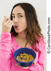 Woman eating porridge
